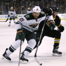 Boston Bruins center Gregory Campbell, right, chases Minnesota Wild center Kyle Brodziak (21) during the first period of an NHL hockey game, Monday, March 17, 2014, in Boston The Associated Press