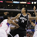 Brooklyn Nets' Shaun Livingston, center, passes the ball as he is defended by Los Angeles Clippers' DeAndre Jordan, left, and Matt Barnes during the second half of an NBA basketball game on Saturday, Nov. 16, 2013, in Los Angeles The Associated Press