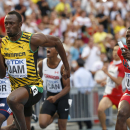 Jamaica's Usain Bolt, left, and United States' Justin Gatlin compete in the men's 4x100-meter relay final at the World Athletics Championships in the Luzhniki stadium in Moscow, Russia, Sunday, Aug. 18, 2013. (AP Photo/Matt Dunham)