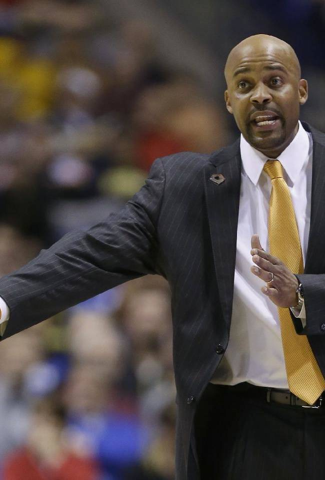 AP Source: Martin pulls name from Marquette search