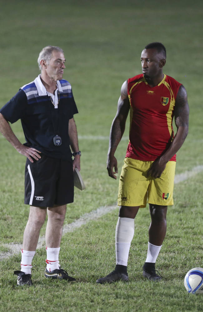 Guinea national soccer team coach, Michel Dussuyer, left, speaks to player Kamil Zayatte, right,  during a training session at the Estadio De La Paz ahead of their quarterfinal match against Ghana, at Estadio De Malabo in Malabo, Equatorial Guinea, Friday, Jan. 30, 2015