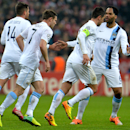 Manchester City's scorer James Milner, second left, and his teammates react during the Champions League group D soccer match between FC Bayern Munich and Manchester City, in Munich, southern Germany, Tuesday, Dec. 10, 2013