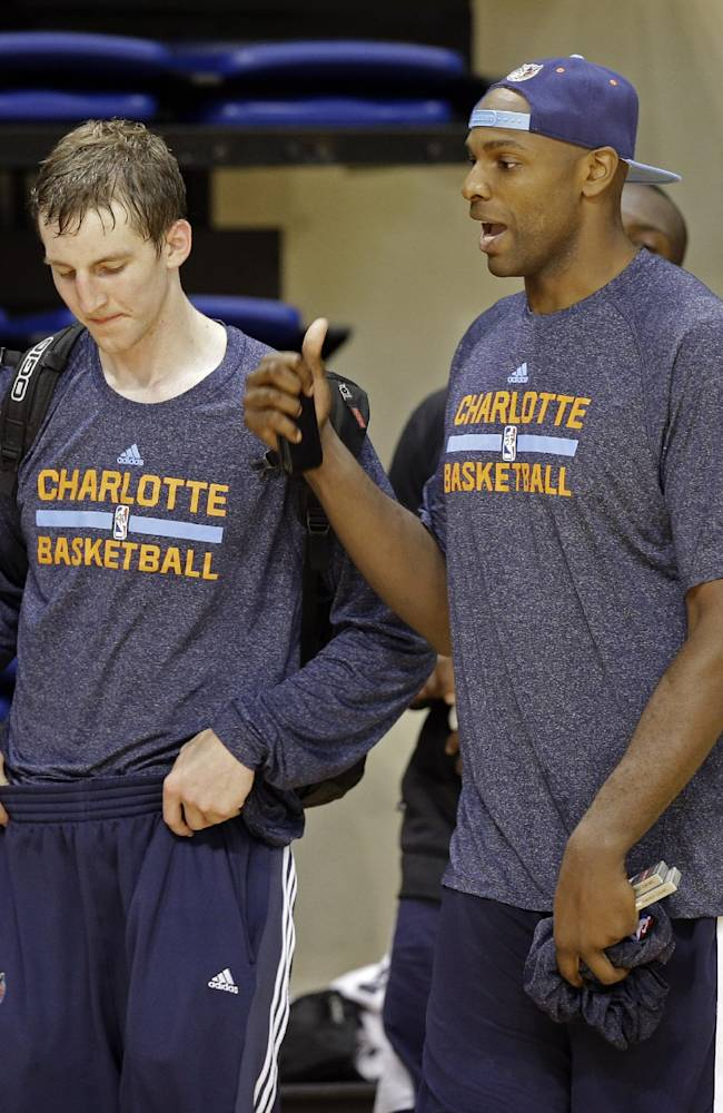 Charlotte Bobcats' Brandan Haywood, right, talks with Cody Zeller, left, after a practice at the NBA basketball team's training camp in Asheville, N.C., Wednesday, Oct. 2, 2013