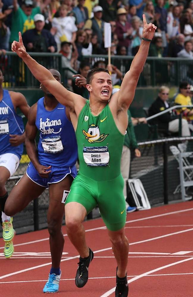 In this June 14, 2014, file photo, Oregon's Devon Allen celebrates after winning the men's 110-meter hurdles at the NCAA track and field championships, in Eugene, Ore. In June, Allen won the NCAA championship in the 110-meter hurdles. Two months later, he's won the job a starting receiver for the No. 3 Ducks. Allen, a redshirt freshman, will start along with senior Keanon Lowe at receiver when Oregon hosts South Dakota in the opener on Saturday night