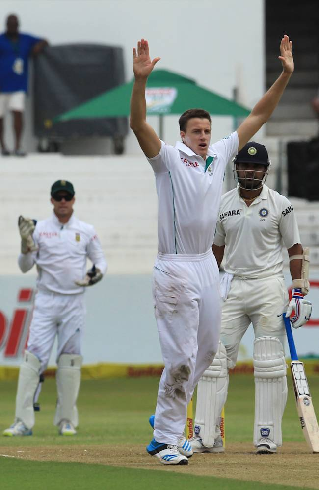 South Africa's bowler Morne Morkel, center, unsuccessfuly appeals for LBW against India's batsman Cheteshwar Pujara, right, as teammate wicketkeeper Abraham Benjamin de Villiers, left, watches during first day of their cricket test match at Kingsmead stadium, Durban, South Africa, Thursday, Dec. 26, 2013