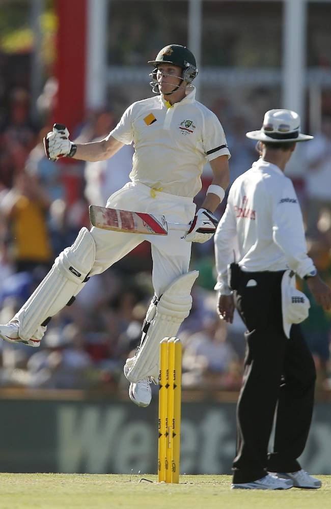 Australia's Steve Smith jumps in the air to celebrate scoring 100 runs against England on the first day of their Ashes cricket test match in Perth, Australia, Friday Dec. 13, 2013