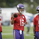Minnesota Vikings quarterbacks, from left, Christian Ponder, Matt Cassel and Teddy Bridgewater wait to participate in a drill during NFL football training camp, Friday, July 25, 2014, in Mankato, Minn The Associated Press
