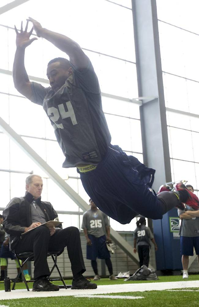 Jovon Mclaughlin jumps Saturday, March 22, 2014, during practice drills at an NFL football regional combine in Renton, Wash