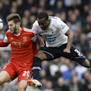 Tottenham's Danny Rose, right, vies for the ball with Southampton's Adam Lallana during the English Premier League soccer match between Tottenham Hotspur and Southampton at White Hart Lane stadium in London, Sunday, March 23, 2014