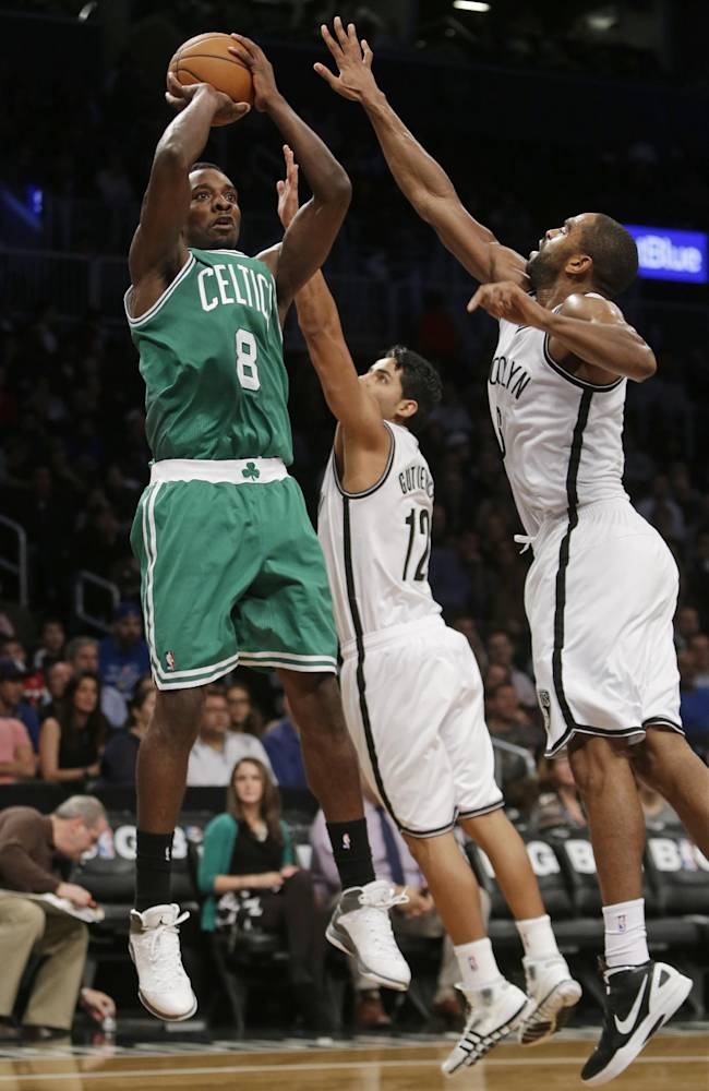 Boston Celtics' Jeff Green (8) shoots over Brooklyn Nets' Jorge Gutierrez (12) and Alan Anderson (6) during the second half of a preseason NBA basketball game Tuesday, Oct. 15, 2013, in New York.  The Nets won 82-80