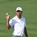 Tiger Woods catches his golf ball on the ninth green during the pro-am for the Phoenix Open at TPC Scottsdale, Wednesday Jan. 28, 2015, in Scottsdale, Ariz. (AP Photo/The Arizona Republic, Rob Schumacher)