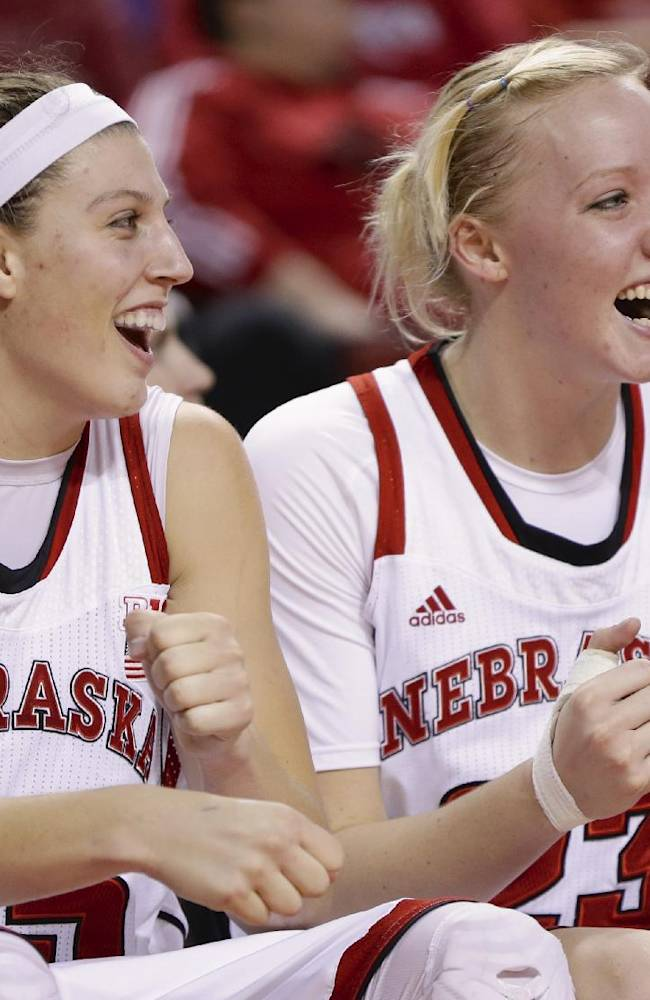 Nebraska's Jordan Hooper, left, and Emily Cady laugh on the bench in the final minutes of the second half of an NCAA college basketball game against UMass-Lowell in Lincoln, Neb., Wednesday, Nov. 27, 2013. Nebraska won 77-42