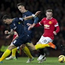 Manchester United's Wayne Rooney, right, attempts to beat Southampton's Jose Fonte, left, as Florin Gardos looks on during the English Premier League soccer match between Manchester United and Southampton at Old Trafford Stadium, Manchester, England, Sund