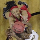 California forward Gennifer Brandon (25) and Louisville forward Cortnee Walton (13) go after a rebound in the second half of a national semifinal at the Women's Final Four of the NCAA college basketball tournament, Sunday, April 7, 2013, in New Orleans. (AP Photo/Dave Martin)