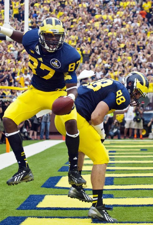 Michigan tight end Devin Funchess (87) celebrates his touchdown with tight end Jake Butt (88) in the second quarter of an NCAA college football game against Minnesota, Saturday, Oct. 5, 2013, in Ann Arbor, Mich