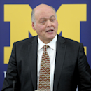 Former Steelcase CEO Jim Hackett speaks after being introduced as the University of Michigan's interim athletic director during a news conference in Ann Arbor, Mich., Friday, Oct. 31, 2014. University of Michigan President Mark Schlissel announced that at