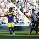 Swansea City's Wilfried Bony, left, celebrates his goal during their English Premier League soccer match against Newcastle United at St James' Park, Newcastle, England, Saturday, April 19, 2014
