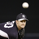 New York Yankees relief pitcher David Robertson warms up in the fourth inning of a spring exhibition baseball game against the Philadelphia Phillies in Tampa, Fla., Tuesday, March 25, 2014 The Associated Press