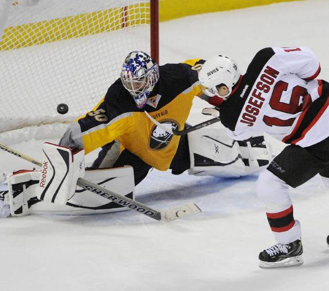 Buffalo Sabres goaltender Nathan Lieuwen (50), of the Czech Republic, gets beat for a goal by New Jersey Devils center Jacob Josefson (16), of Sweden, during the team shootout of an NHL hockey game in Buffalo, N.Y., Tuesday, April 1, 2014. Buffalo won 3-2
