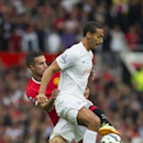 Manchester United's Robin van Persie, left, fights for the ball against former teammate, Queens Park Rangers player Rio Ferdinand during their English Premier League soccer match at Old Trafford Stadium, Manchester, England, Sunday Sept. 14, 2014