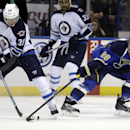 Winnipeg Jets' Tobias Enstrom, of Sweden, controls the puck as St. Louis Blues' Dmitrij Jaskin, right, of Russia, defends during the second period of an NHL hockey game Monday, March 17, 2014, in St. Louis The Associated Press