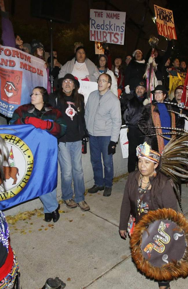 American Indians and their supporters gather outside the Metrodome to protest the Washington Redskins' name, prior to an NFL football game between the Redskins and the Minnesota Vikings, Thursday, Nov. 7, 2013, in Minneapolis