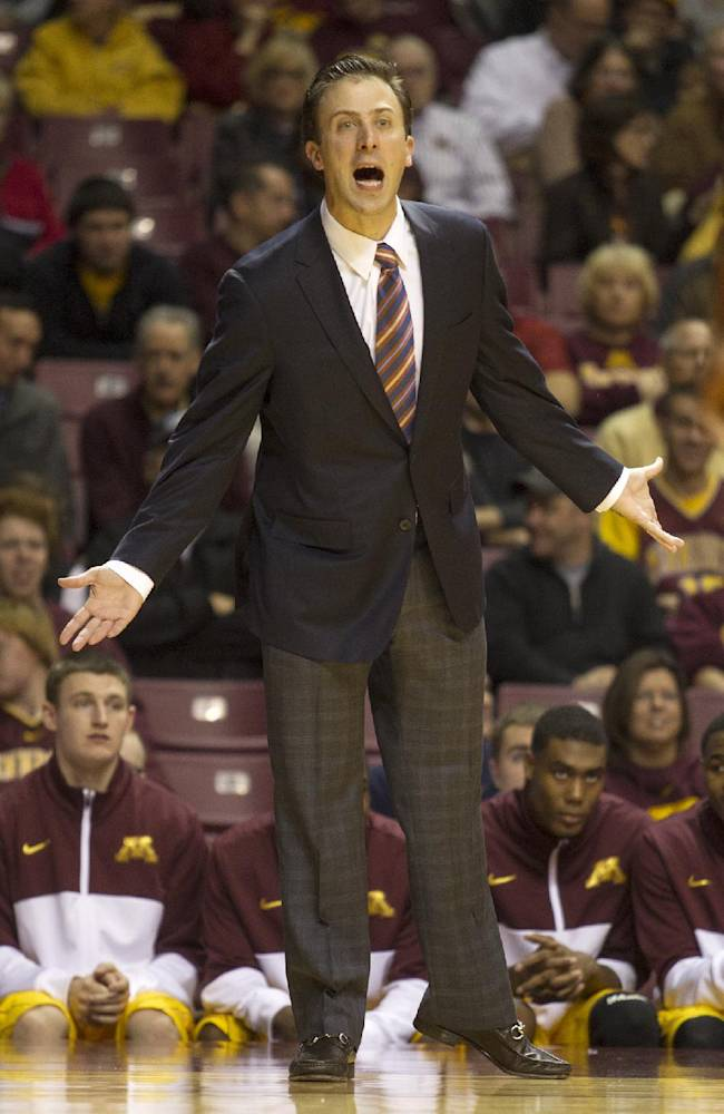 Minnesota head coach Richard Pitino yells to his team during the first half of an NCAA college exhibition basketball game, Monday, Nov. 4, 2013, in Minneapolis. Minnesota won 101-67