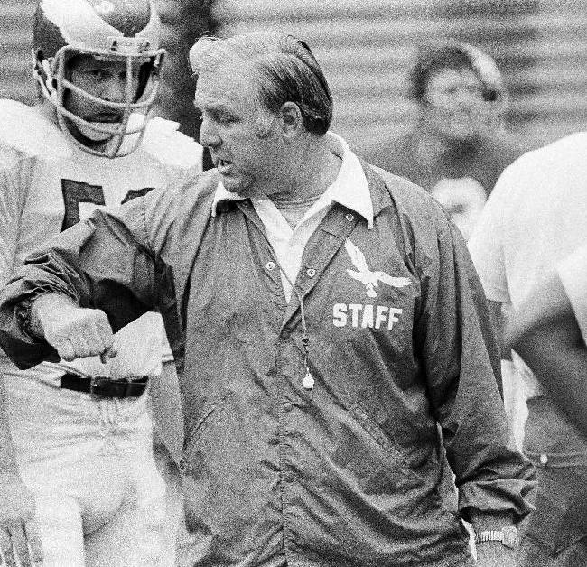 In this Sept. 19, 1975, file photo, Philadelphia Eagles head coach Mike McCormack demonstrates what he means to Eagles' linebacker Dean Halverson during an NFL football workout at Veterans Stadium in Philadelphia. McCormack, a Hall of Fame offensive lineman died Fridaym, Nov. 15, 2013, in Palm Desert, Calif. He was 83. During his nearly 50 years in professional football, McCormack played, coached and held several executive positions