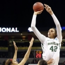 FILE - In this April 1, 2013, file photo, Baylor's Brittney Griner shoots over Louisville players during the second half of a regional semifinal game in the women's NCAA college basketball tournament in Oklahoma City. Griner was selected as The Associated Press' women's college basketball player of the year on Saturday, April 6, 2013.(AP Photo/Sue Ogrocki, File)