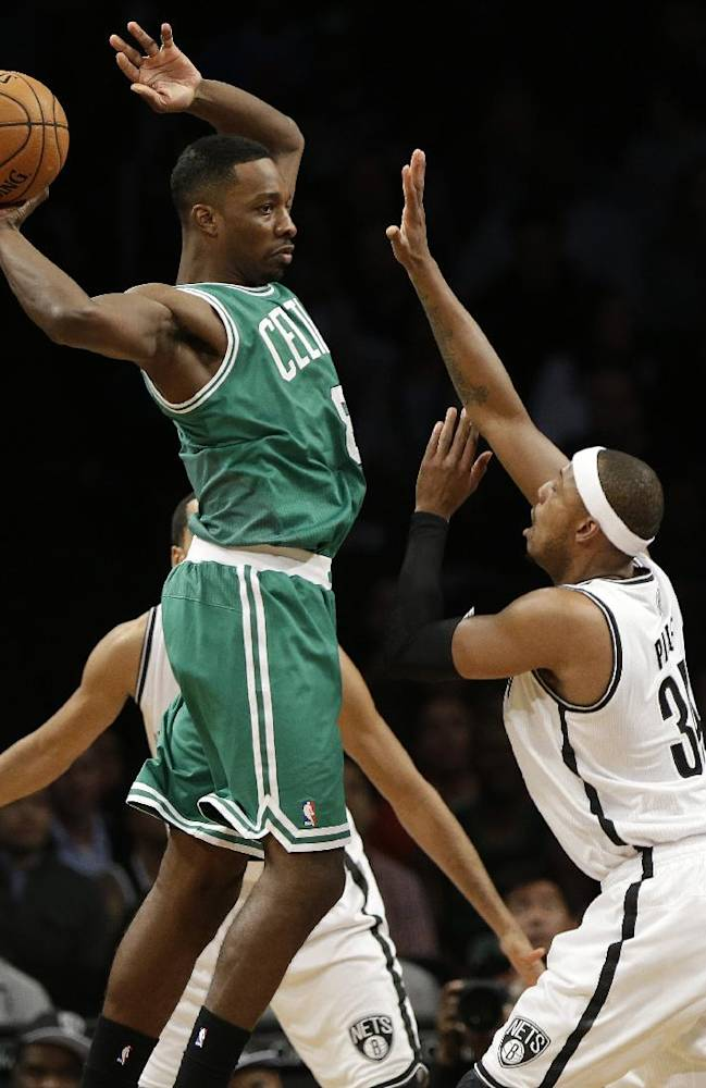 Boston Celtics' Jeff Green (8) passes away from Brooklyn Nets' Paul Pierce (34) during the first half of a preseason NBA basketball game Tuesday, Oct. 15, 2013, in New York