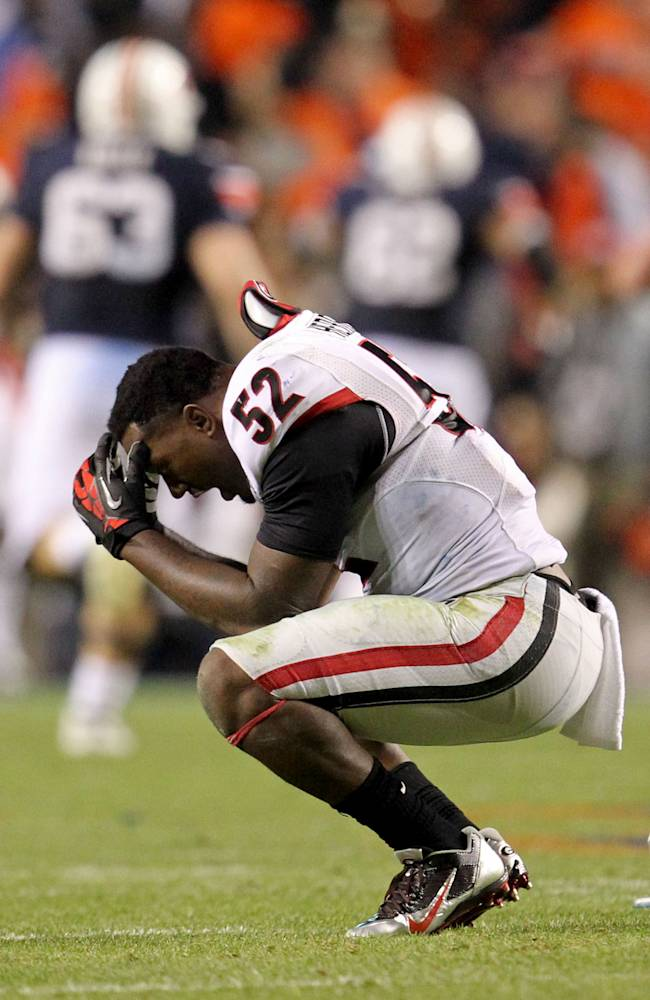 Georgia linebacker Amarlo Herrera (52) reacts after Auburn Tigers scored the game-winning touchdown late in the fourth quarter of an NCAA college football game at Jordan-Hare Stadium on Saturday, Nov. 16, 2013. Auburn won 43-38