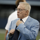 In this Aug. 28, 2014, file photo, Dallas Cowboys owner Jerry Jones looks on before an NFL preseason football game against the Denver Broncos in Arlington, Texas. The usually optimistic Jerry Jones is using