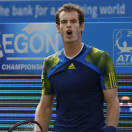 Andy Murray of Britain reacts to a point loss to Marin Cilic of Croatia during their Queen's Club grass court championships single final tennis match in London, Sunday, June 16, 2013. (AP Photo/Sang Tan)