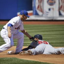 New York Mets shortstop Omar Quintanilla, left, tags out Atlanta Braves' Jason Heyward as he tries to steal second base during the first inning of a baseball game at Citi Field, Sunday, April 20, 2014 in New York The Associated Press