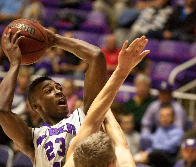Weber State University's Richaud Gittens makes a fade away, while playing against Eastern Washington University during an NCAA college basketball game,  Thursday, Jan. 2, 2014, in Ogden, Utah