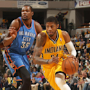 Paul George #24 of the Indiana Pacers handles the ball against the Oklahoma City Thunder at Bankers Life Fieldhouse on April 13, 2014 in Indianapolis, Indiana. (Photo by Ron Hoskins/NBAE via Getty Images)