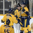 Nashville Predators center Filip Forsberg (9) celebrates with center Derek Roy (21), defenseman Ryan Ellis (4) and center Craig Smith (15) after Forsberg scored against the Calgary Flames in the first period of an NHL hockey game Tuesday, Oct. 14, 2014, i