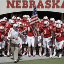 Nebraska's head coach Bo Pelini leads his squad onto the playing field prior to their NCAA college football game against Arkansas State in Lincoln, Neb., Saturday, Sept. 15, 2012. (AP Photo/Nati Harnik)