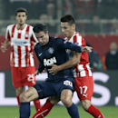 Olympiakos' Herman Perez, right, fights for the ball with Manchester United's Robin Van Persie during their Champions League, round of 16, first leg soccer match at Georgios Karaiskakis stadium, in Piraeus port, near Athens, on Tuesday, Feb. 25, 2014