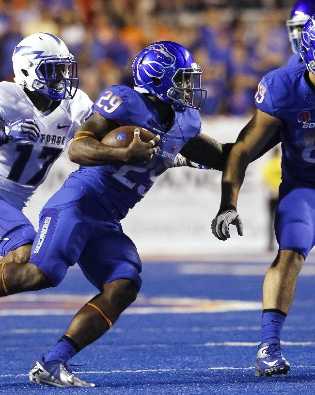 Boise State tight end Connor Peters (89) blocks as running back Aaron Baltazar (29) runs past Air Force defensive back Jamal Byrd (17) during the second half of of an NCAA college football game in Boise, Idaho, Friday, Sept. 13, 2013. Boise State won 42-20