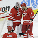 Carolina Hurricanes goalie Cam Ward (30) is congratulated by Andrej Sekera (4), of Slovakia, as Nathan Gerbe (14) skates in following the Hurricanes' 5-2 win over the Buffalo Sabres in an NHL hockey game in Raleigh, N.C., Thursday, Jan. 8, 2015 The Associ