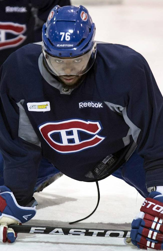 Montreal Canadiens defenseman P.K. Subban stretches during NHL hockey practice Wednesday, April 30, 2014, in Brossard, Quebec. The Canadiens face the Boston Bruins in Game 1 in the second round of the Stanley Cup playoffs Thursday in Boston