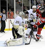 New Jersey Devils' Jaromir Jagr (68), of Czech Republic, watches the puck go into the net past Pittsburgh Penguins goaltender Marc-Andre Fleury, left, for a goal by Devils' Adam Larsson during the second period of an NHL hockey game Saturday, Nov. 16, 2013, in Newark, N.J. (AP Photo/Bill Kostroun)