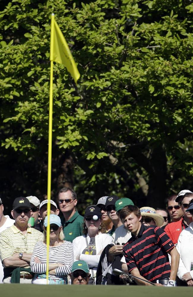 Matthew Fitzpatrick, of England, hits to the first green during the first round of the Masters golf tournament Thursday, April 10, 2014, in Augusta, Ga