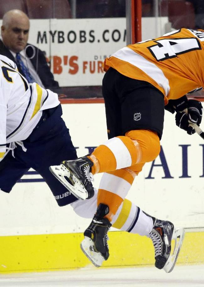 Philadelphia Flyers' Matt Read, right, is sent flying after a collision with Buffalo Sabres' Zemgus Girgensons, of Latvia, during the first period of an NHL hockey game Thursday, Nov. 21, 2013, in Philadelphia