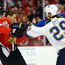 Chicago Blackhawks center Michal Handzus and St. Louis Blues center Steve Ott fight in Game 4 of a first-round NHL hockey playoff series in Chicago, Ill. on Wednesday, April 23, 2014. (AP photo/Daily Herald, John Starks) The Associated Press