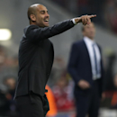 Bayern's head coach Pep Guardiola reacts during the Champions League Group E soccer match between FC Bayern Munich and Manchester City at Allianz Arena in Munich, southern Germany, Wednesday Sept. 17, 2014