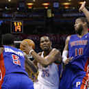Oklahoma City Thunder forward Kevin Durant (35) drives between Detroit Pistons guard Kentavious Caldwell-Pope (15) and forward Greg Monroe (10) during the fourth quarter of an NBA basketball game in Oklahoma City, Wednesday, April 16, 2014. Oklahoma City