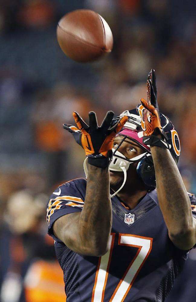 Chicago Bears wide receiver Alshon Jeffery (17) catches a pass as players warm up for an NFL football game against the New York Giants, Thursday, Oct. 10, 2013, in Chicago