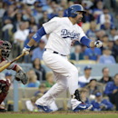 Los Angeles Dodgers' Adrian Gonzalez, right, hits a two-RBI single during the fifth inning of a baseball game against the Arizona Diamondbacks, Saturday, April 19, 2014, in Los Angeles The Associated Press